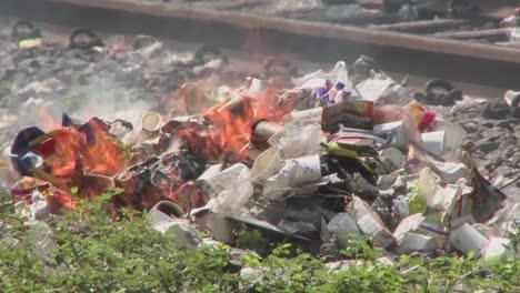 Burning-rubbish-piles-close-by-railroad-tracks