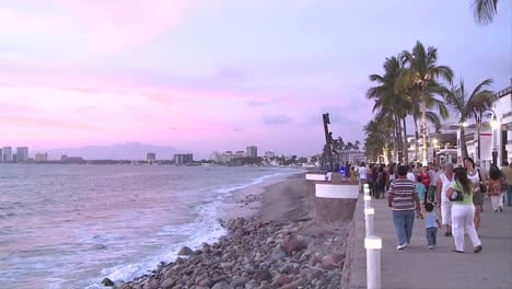 Malecon-in-Puerto-Vallarta-Mexico-We-see-the-sculptures-on-the-beach-walk-the-tourism-resort-buildings-in-the-horizon