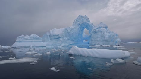 Antarctica-Port-Charcot-Ice-Arch-reflection-iceberg-illustrates-fragile-global-warming