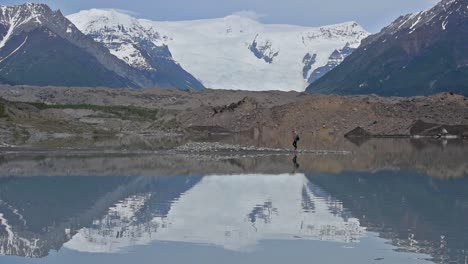 Icefalls-and-Root-Glacier-hiker-water-reflection-in-McCarthy-Alaska