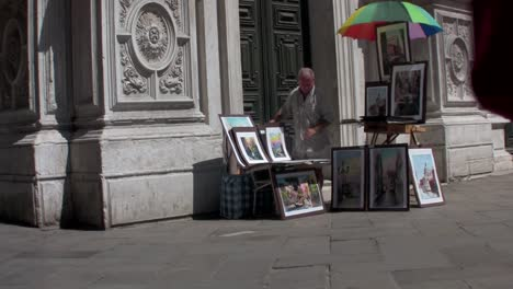 A-street-artist-paints-outside-a-cathedral-in-Paris