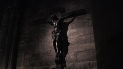 A-spooky-scene-of-Jesus-on-cross-from-a-darkened-church