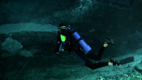 A-scuba-diver-explores-underwater-caves-in-Florida
