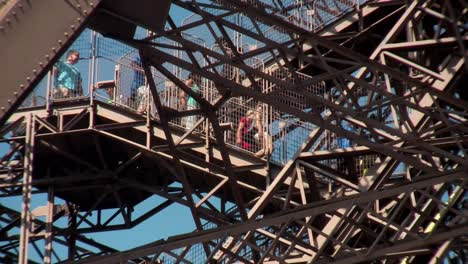 Tourists-walk-on-the-Eiffel-Tower-in-paris