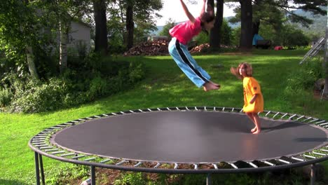 Kids-jump-and-play-on-the-trampoline-in-the-backyard