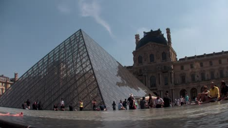 Crowds-of-people-walk-around-the-grounds-of-Louvre-in-Paris-1