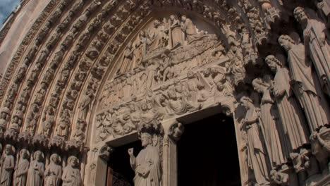 Handheld-tilt-up-facade-of-Notre-Dame-Cathedral-Paris-France