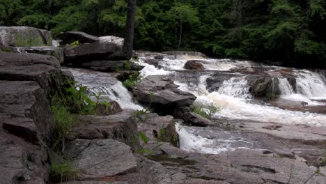A-waterfall-flows-through-the-forest-in-New-Hampshire