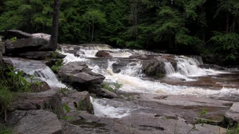 A-waterfall-flows-through-the-forest-in-New-Hampshire-1