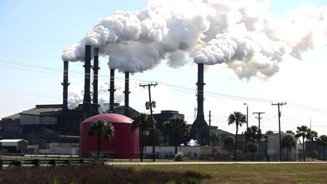A-power-plant-with-smokestacks-belches-smoke-into-the-air-1