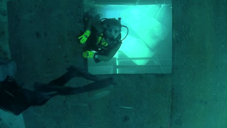 Divers-explore-a-shipwreck-1