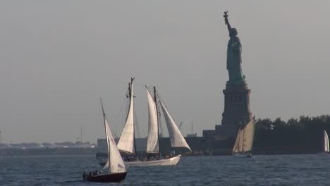 Sailboats-pass-in-front-of-the-Statue-Of-Liberty-in-New-York-harbor