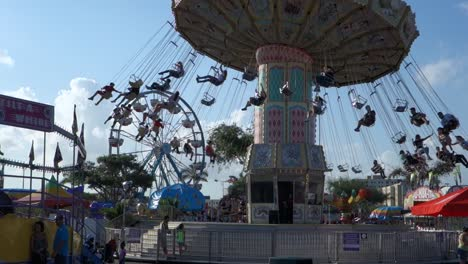A-merry-go-round-spins-with-riders-against-the-sky