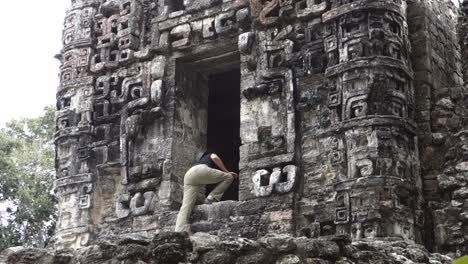 A-woman-explores-the-ancient-and-mysterious-Mayan-temple