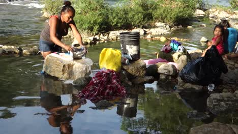 Women-wash-clothes-in-a-river-in-a-third-world-country