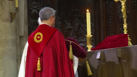 Inside-Catholic-Notre-Dame-Cathedral-in-Paris-religious-visitors-kiss-the-holy-relic-2