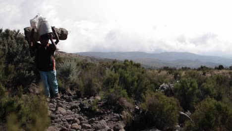 Porters-carrying-gear-down-trail