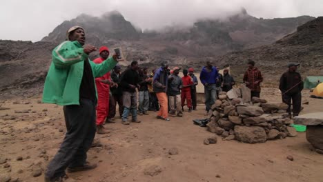 Porters-dance-at-the-base-of-the-mountain