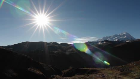 Sun-burst-with-snowy-peak-in-the-background