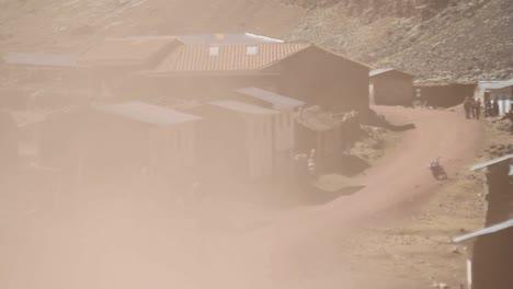 Truck-drives-fast-through-village