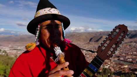 Traditional-musician-Cusco-in-background