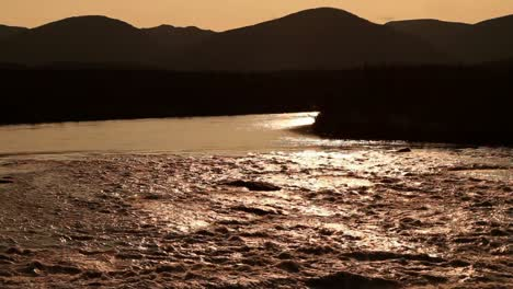 Flowing-river-shining-in-the-setting-sun