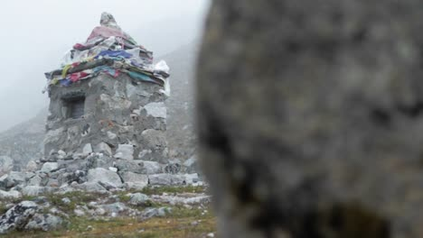 Wider-shot-of-cairn-from-behind-rock