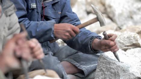 Stonemasons-chiseling-away-rock