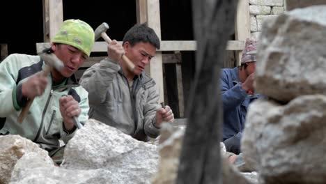 Pan-of-stone-masons-chiseling