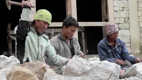 Mason-hammering-away-at-stone