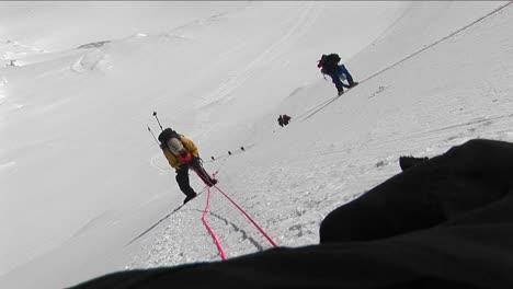 Climbers-climbing-down-steep-slope