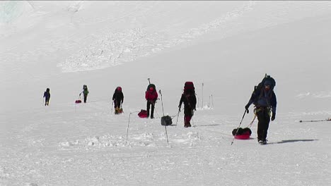 Climbers-with-sleds-approaching-camp