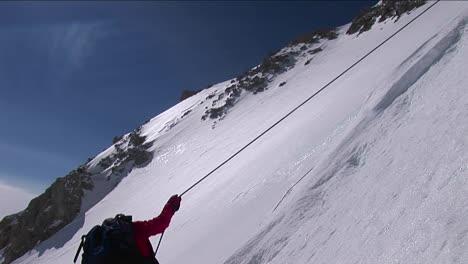 Climber-descending-down-slope