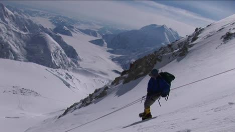 Climber-carefully-descending-steep-slope