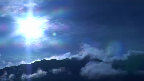 Mountain-in-the-clouds-under-blue-light