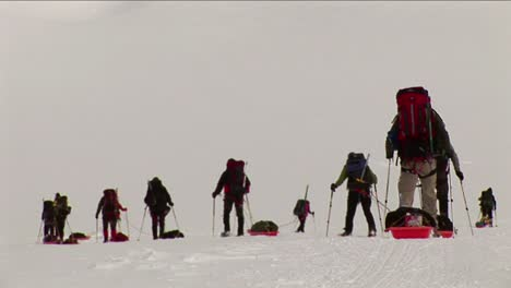 Climbers-with-snowshoes-and-sleds