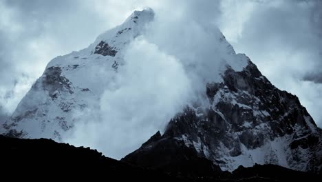 Dark-peak-with-clouds-moving-around-it