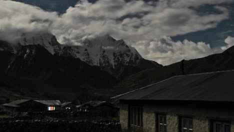 Pheriche-village-at-night-with-clouds-rolling