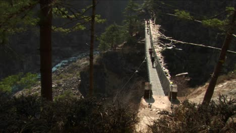 Crossing-large-suspension-bridge-over-gorge