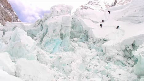 Climbers-dwarfed-by-ice-formations