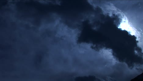 Pan-onto-peak-in-pale-blue-light-with-clouds
