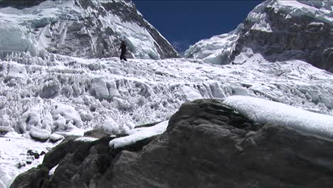 Pan-from-rock-revealing-climber-near-icefall