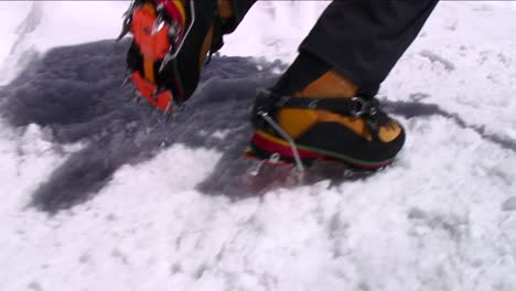 Crampons-digging-into-snow-as-climber-ascends