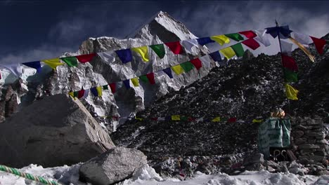 Puja-alter-with-prayer-flags-and-mountain-behind