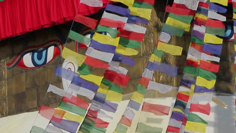 Prayer-flags-streaming-in-front-of-Adi-Buddha