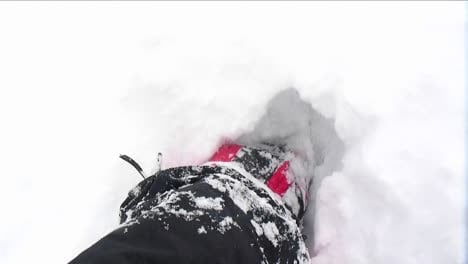 POV-of-climber-walking-through-deep-snow