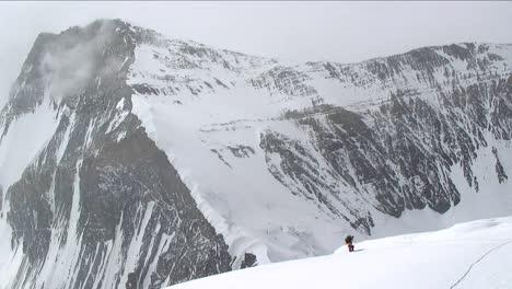 Climber-ascending-north-side-up-snow-slope