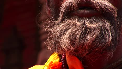 Pan-up-of-Sadhu-on-streets-of-Kathmandu
