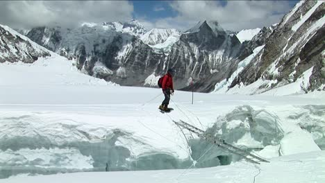 Climber-crosses-large-crevasse-above-camp-one