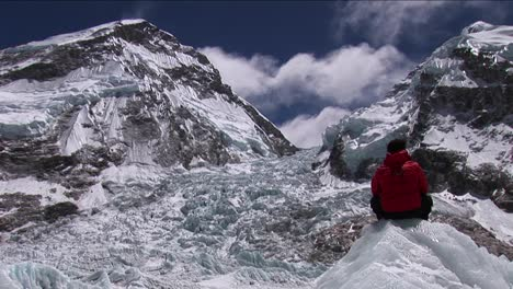 Climber-sitting-looking-out-at-Khumbu-icefall
